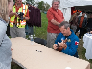 Chris Hadfield playing ukulele.