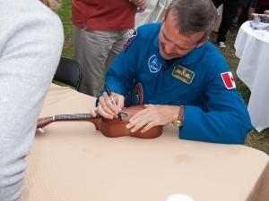 Cmdr. Chris Hadfield autographing my ukulele.